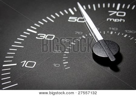 kilometers an hour in black with white numerals