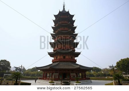 SUZHOU, CHINA - NOVEMBER 23: Tourist visits the Ruiguang pagoda at Panmen Gate on November 23, 2011 in Suzhou, China. This ancient pagoda was completed in 247BC and is an important tourist destination