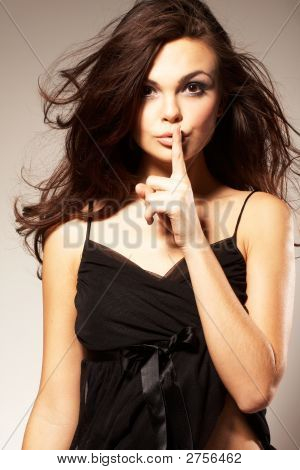 Young Woman Gesturing For Quiet Or Shushing