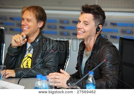 MOSCOW - MAY 6: (L-R) Popular Dutch DJ Armin Van Buuren and English musician Christian Burns smile at press conferences, on May 6, 2011 in Moscow, Russia.