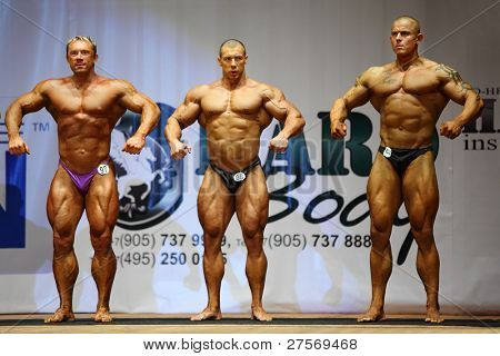 MOSCOW - APRIL 16: Mityushin Yuri, Tronov Alexey, Petrov Alexey compete at Open Cup of bodybuilding and fitness of Moscow in hall at hotel Cosmos, on April 16, 2011 in Moscow, Russia.