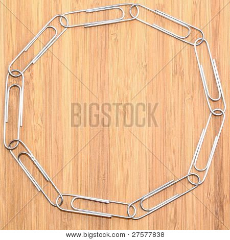 Paper Clips Linked In A Ring On Wooden Background