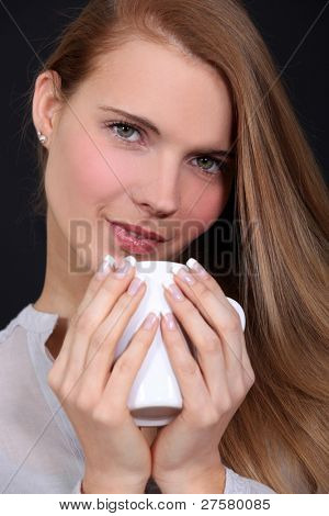 Woman holding mug of coffee