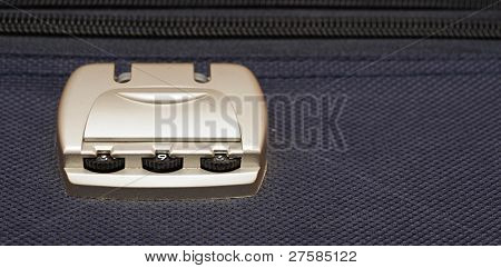 closeup photo of a combination lock on a black suitcase