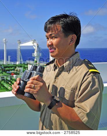 Navigation Officer With A Binocular