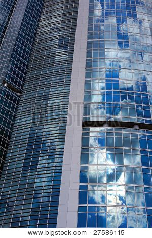 Glass And Steel Tower With Sky Reflection