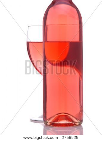Wineglass Behind Blush Wine Bottle