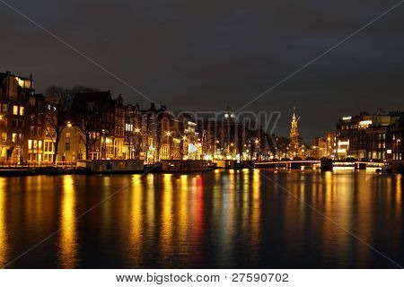 Amsterdam at night with the Munt tower in the Netherlands