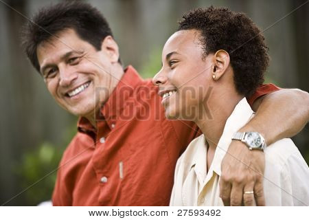 Hispanic father with African American teenage son