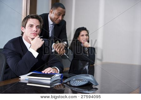 Multi-ethnic business executives meeting in boardroom