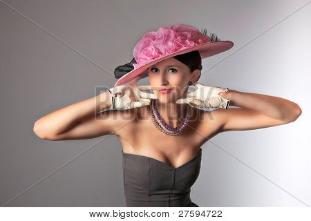 Young stylich woman with purple retro hat