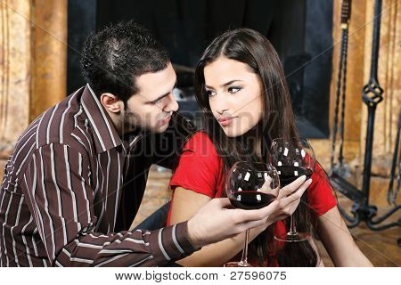Couple In Love Near Fireplace