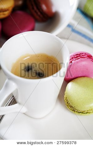 Espresso and fresh colorful macaroons