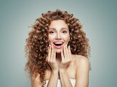 Exited Screaming Young Woman Portrait. Surprised Girl Student With Long Curly Hair. Surprise. Positi poster