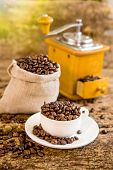 Cup Of Coffee Beans. Coffee Grinder And Bag With Coffee Beans In The Background. Coffee. Coffee Bean poster