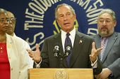NEW YORK - AUGUST 15:  New York City Mayor Michael Bloomberg (C) speaks about heat related issues af