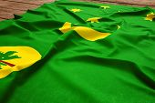 Flag Of Cocos Islands On A Wooden Desk Background. Silk Flag Top View. poster