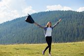 Success Concept. Hiker Woman Cheering Elated And Blissful With Arms Raised In Sky After Hiking To Mo poster