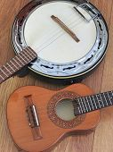 Close-up Of Two Brazilian Musical Instruments: Cavaquinho And Samba Banjo On A Wooden Surface. They  poster