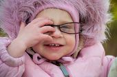 Closeup Of Funny Baby In Glasses