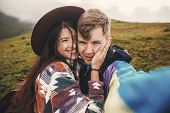 Happy Hipster Couple Making Selfie And Smiling On Top Of  Sunny  Mountains. Stylish Couple In Love T poster