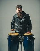 Hipster Style. Man In Biker Leather Jacket. Music Drums. Brutal Caucasian Hipster With Moustache. Ma poster