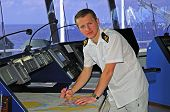 picture of lng  - Navigation officer works with a navigation chart plotting the course on the navigation bridge of ocean ship - JPG