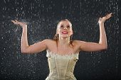 image of jupe  - beautiful girl wearing in dress smiles in rain and catches drops by hands - JPG