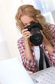 stock photo of storyboard  - Photographer looking at photo camera - JPG