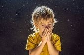Allergy To Dust. Boy Sneezes Because He Is Allergic To Dust. Dust Flies In The Air Backlit By Light poster