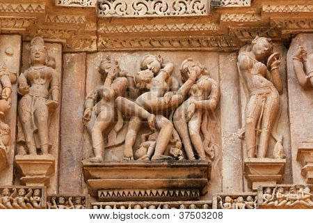 Famous erotic stone carving sculptures, Devi Jagadamba Temple, Khajuraho, India. Unesco World Heritage Site