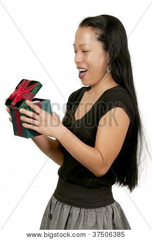 Hispanic Woman Holding A Christmas Present