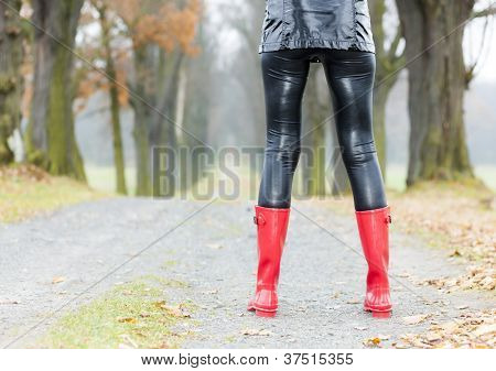 detail of woman wearing red rubber boots