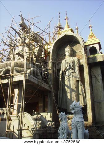 New Buddha Being Built In Temple Area In Thailand.