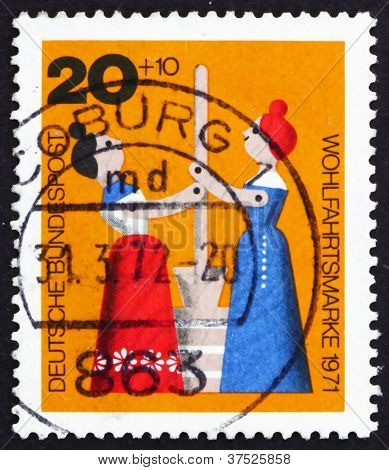 Postage stamp Germany 1971 Women Churning Butter, Wooden Toy