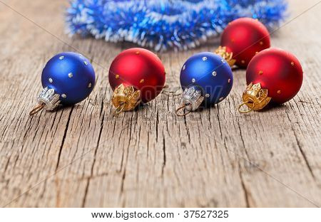 Small New Year decoration balls on old wooden background