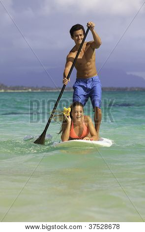 couple on paddle board