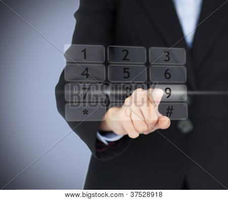 Business woman entering pin on projected digital number pad