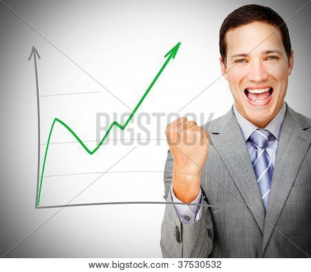 Businessman celebrating behind increasing graph on grey background