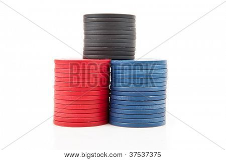 Colourful poker coins against a white background