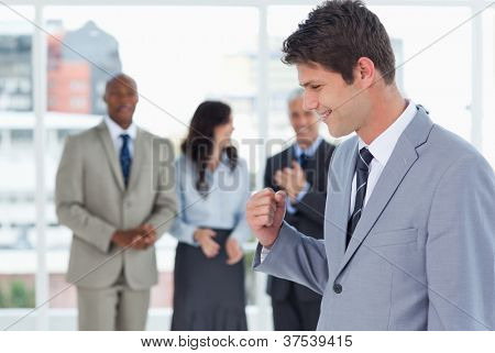 Businessman using his fist to show his great success