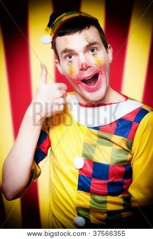 Smiling Circus Clown Standing Inside Bigtop Tent