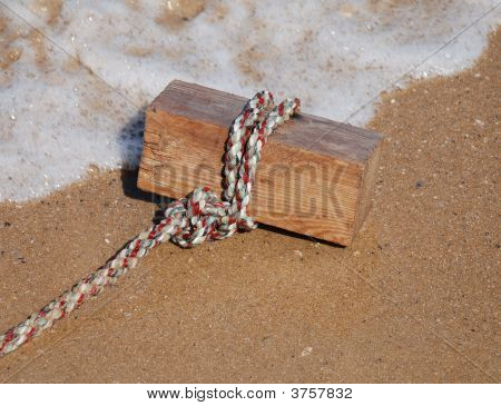 Block On Rope On Beach