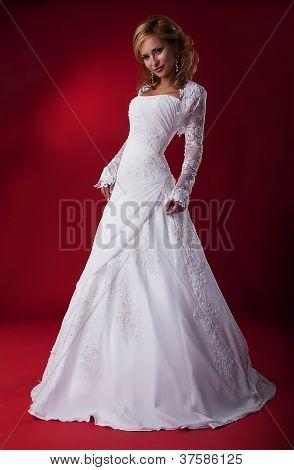 Sensual Fashion Model Bride Blonde In Wedding Dress Posing