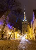stock photo of olaf  - Illuminated street in the Old Town of Tallinn Estonia at night - JPG