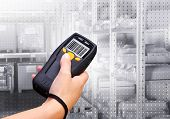 stock photo of barcode  - Handheld Computer for wireless barcode scanning identification - JPG