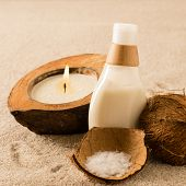 Spa coconut body products lotion on sand