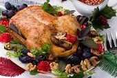 stock photo of christmas dinner  - Garnished roasted duck on Christmas decorated table - JPG
