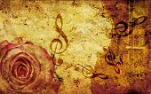 foto of string instrument  - Vintage grunge background with rose and music notes - JPG