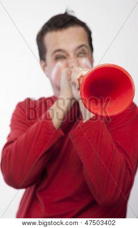 Man blowing vuvuzela